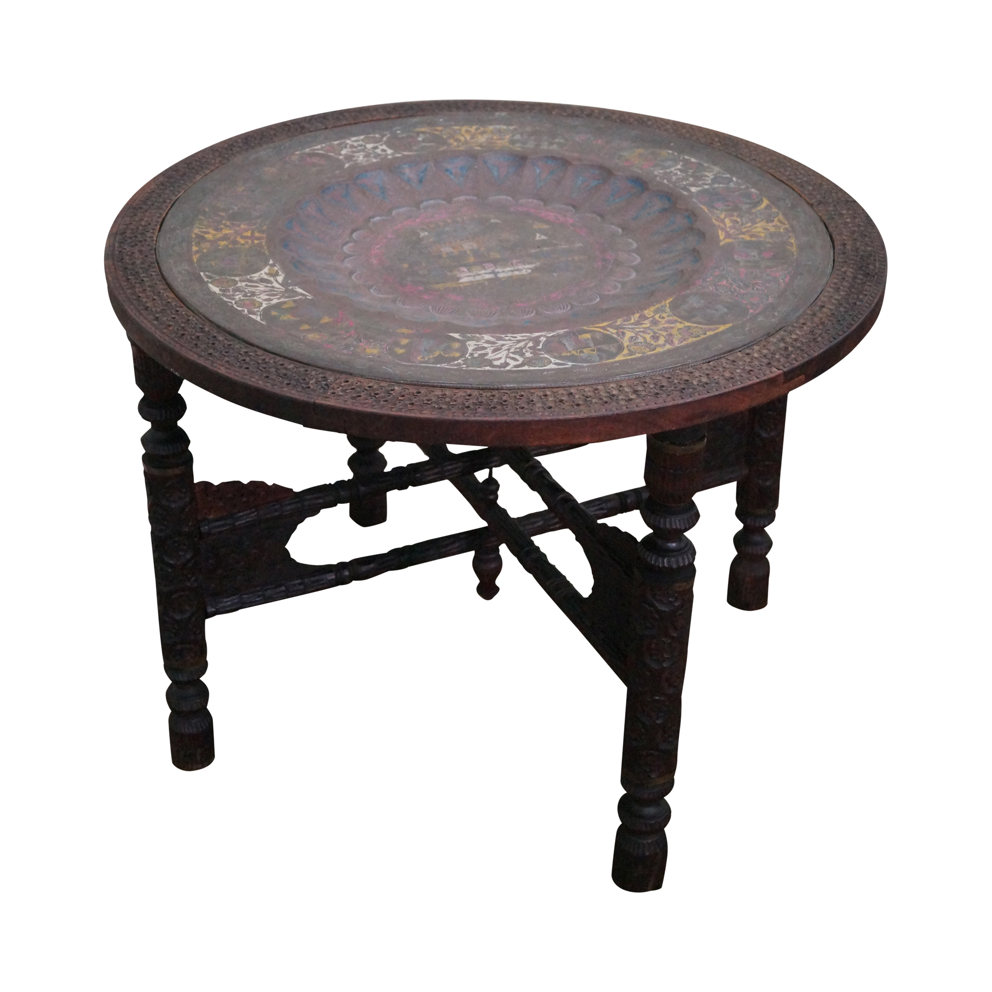 Round carved coffee table with incised brass top chairish Carved coffee table