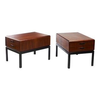 A pair of two toned night stands in the style of Harvey Probber