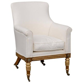 English Regency Upholstered Armchair with Painted and Gilt Wood Legs on Casters