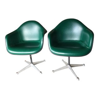 Herman Miller Eames Green Shell Armchairs - a Pair
