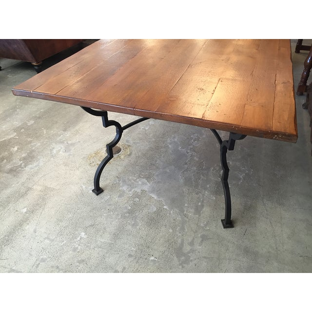 Image of Plank Trestle Table With Iron Base