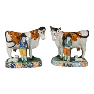 Pair of Yorkshire Prattware Pottery Cows and Figures, Circa 1810-20