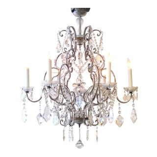 A lustrous and graceful Italian rococo style cage-form beaded 6-light chandelier with crystal pendants, flowers and swags