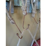 Image of Vintage Life Rings and Weathered Wood Display Rack