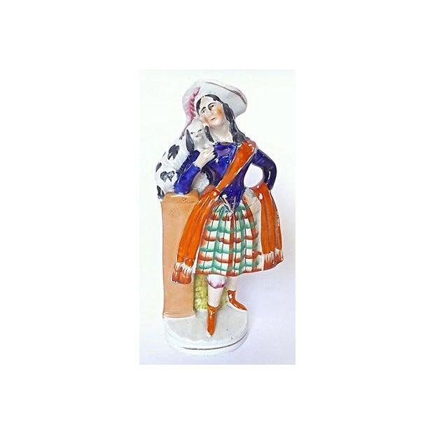 Image of Antique English Staffordshire Woman & Dog Figurine