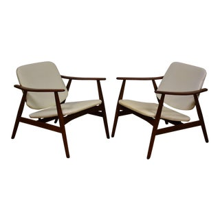 White Lounge Chairs - A Pair