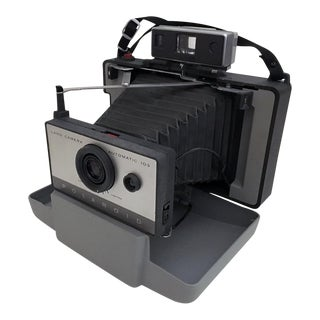 Vintage Polaroid Camera and Accessories