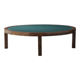 Round coffee table in rosewood with green under-painted glass top