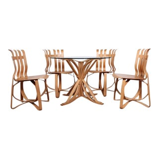 Dining Table and Chairs by Frank Gehry