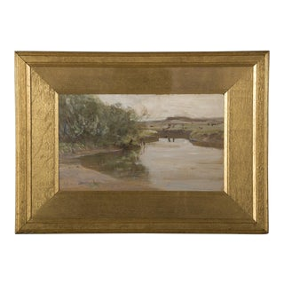 A lovely oil on panel painting of a river landscape signed lower right from England c.1880 in the original gilded frame and glass.