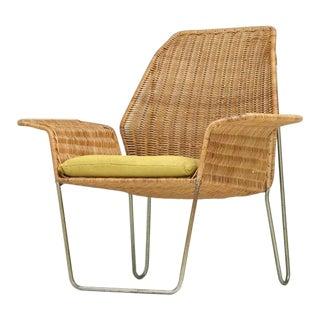 Dutch Design rattan armchair on a bent iron frame, 1960s