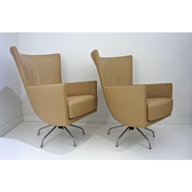 Image of Pair of Modern, Italian, Swivel Lounge Chairs, Upholstered in Tan Color Leather