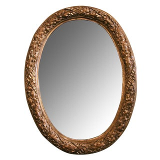 A Large-Scaled and Well Carved French Louis XVI Style Carved Giltwood Oval Mirror with Laurel Leaf Motifs