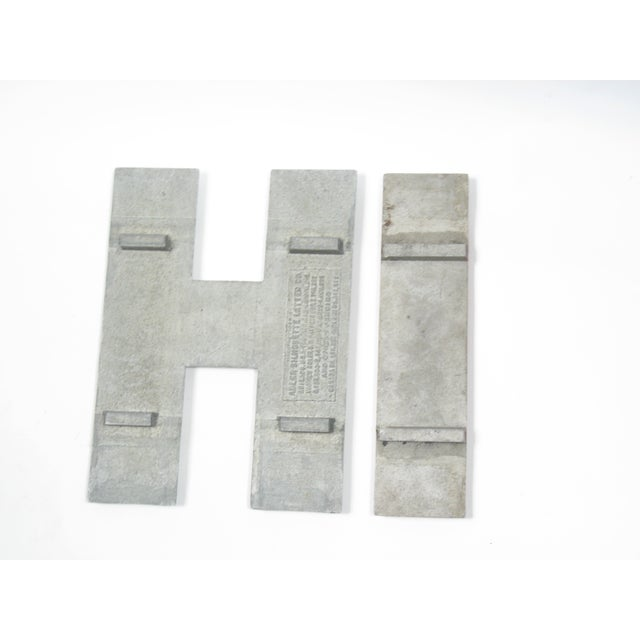 "Image of Vintage Industrial ""H"" and ""I"" Letters"