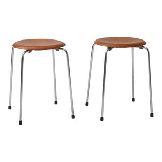 A pair of Arne Jacobsen 'Dot' Stools