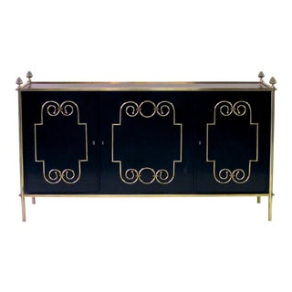 An exquisite American mid-century custom-made black lacquer 3-door sideboard/buffet with applied brass scroll work; by Daniel Jones, Inc. New York