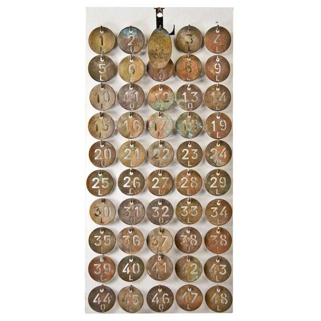 Le Lido Paris Brass Coat Check Tags- Set of 50 - Image 1 of 5
