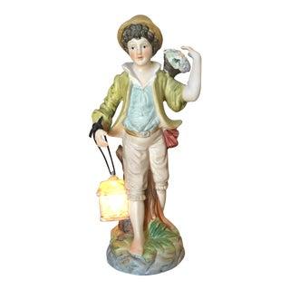 Vintage Boy Holding Lantern Figurine