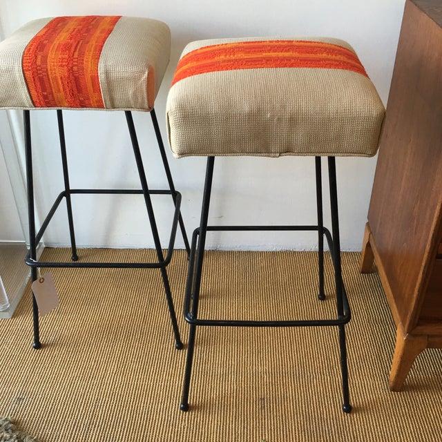 Image of 1950s Orange Striped Barstools - A Pair