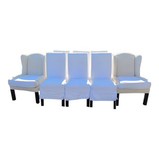 Pair of Slipcovered Low Arm Wing Chairs