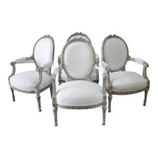Painted and White Linen Upholstered Louis XVI Ribbon Carved Armchairs - Set of 4