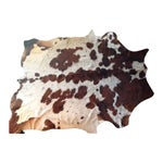 Image of Brown and White Natural Cowhide Rug - 6' x 7'