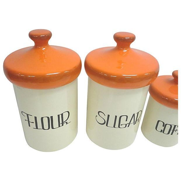 Image of Mid-Century Orange Ceramic Canisters - Set of 4