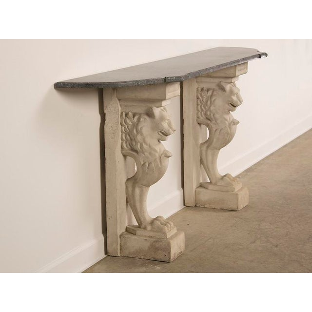 Image of Console/serving table with a 19th c. shaped marble top mounted on a pair of composite stone lion monopodia pedestals from France c.1920.