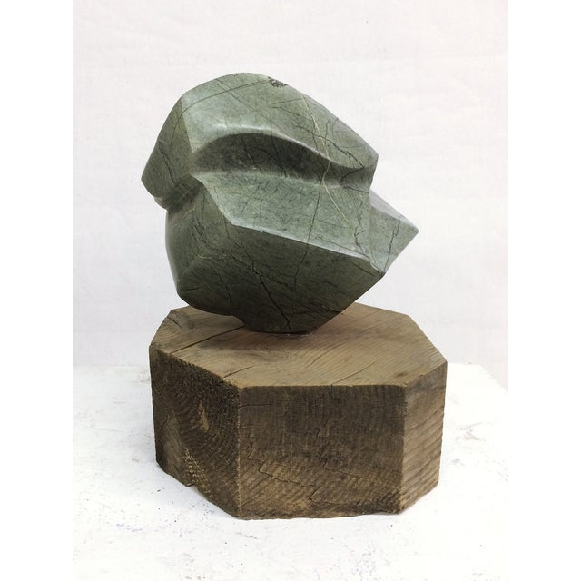 Image of Large Abstract Marble Sculpture on Rough Wood Base