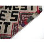 "Image of Hand-Hooked Rug on Mounted Frame ""EAST WEST HOME'S BEST"""
