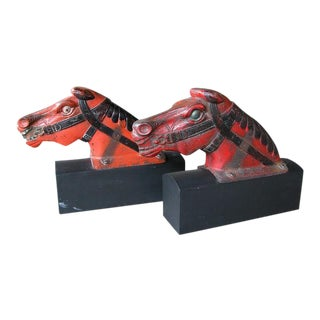 A Playful Pair of English Cast Iron Polychromed Carnival Horse Heads