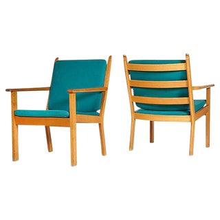 Hans J. Wegner Danish Oak Lounge Chairs - A Pair