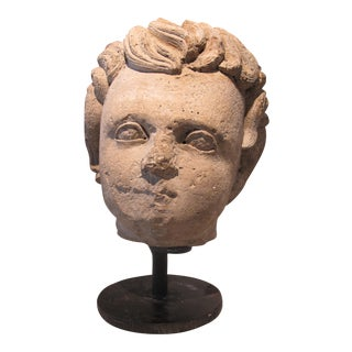 Carved Stone Head Mounted on Metal Base