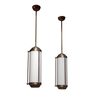 Pair of large brass pendant lamps, Germany
