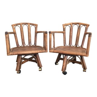 Vintage rattan rolling armchairs with cushions - a Pair