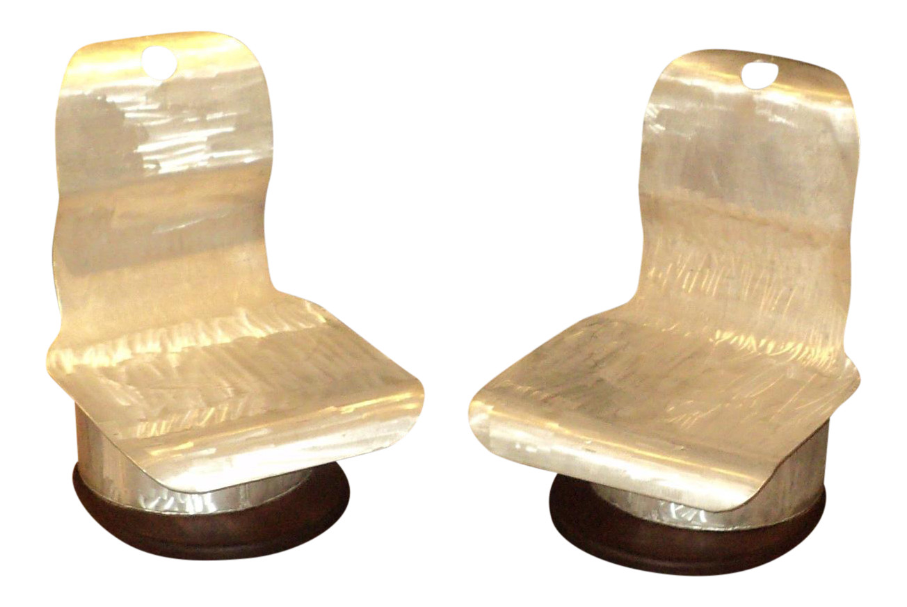a pair of mid century modern space age low chairs