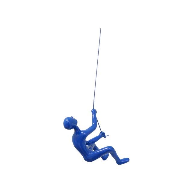 Image of Climbing Man Wall Art Sculpture - Blue