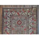 Image of Distressed Vintage Star Kazak Rug - 3′9″ × 5′
