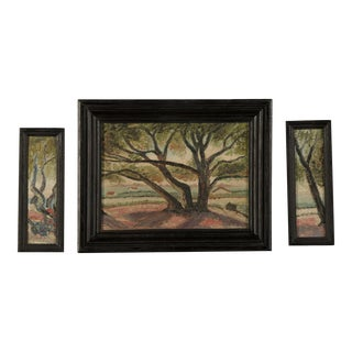 A striking triptych of oil on canvas paintings depicting enormous trees each in the original ebonized frames from France c.1900.