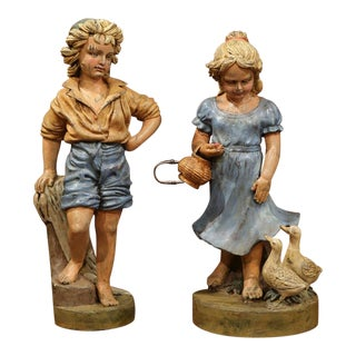Mid-20th Century French Iron Painted Statues of Boy and Girl With Ducks - A Pair