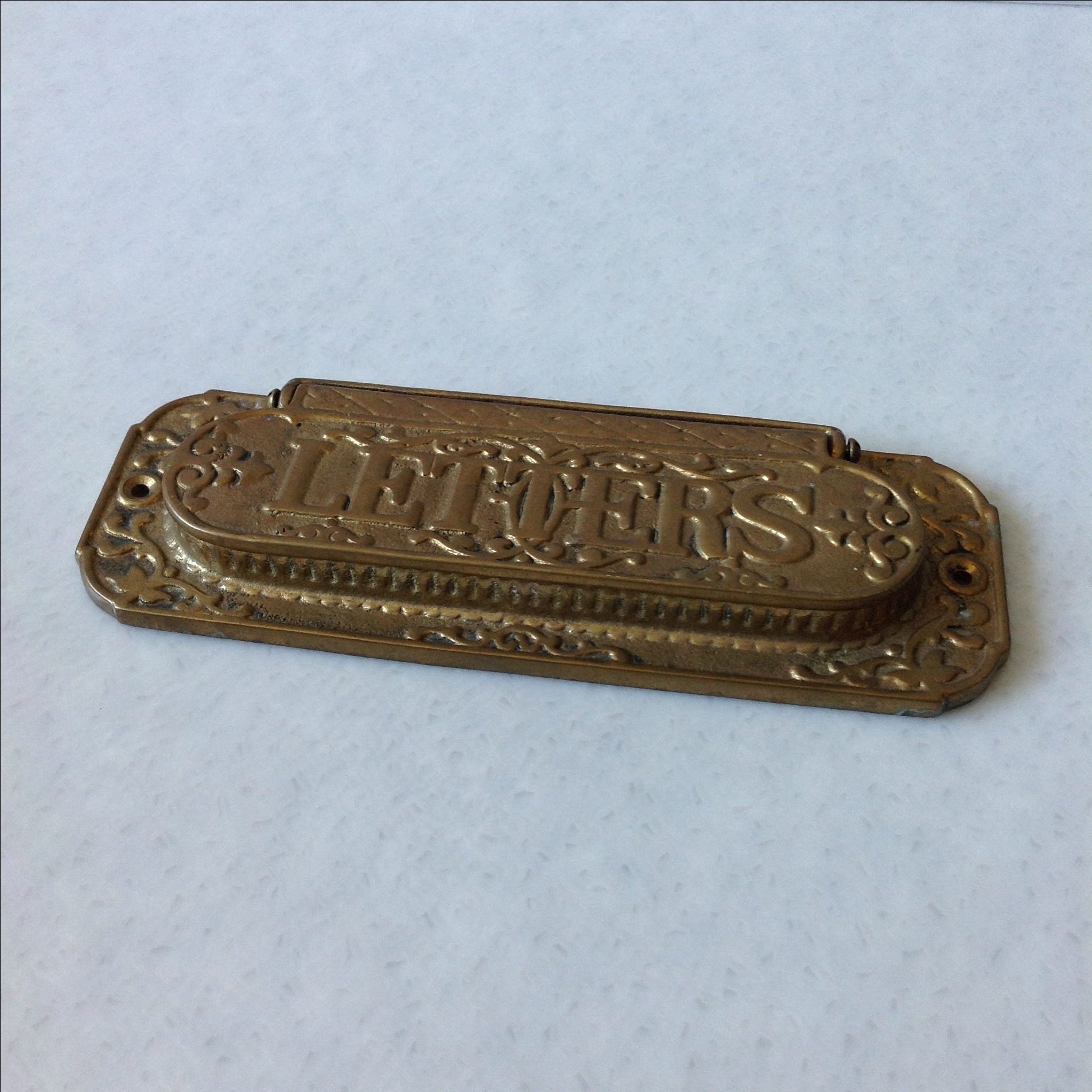 Antique brass mail slots for doors