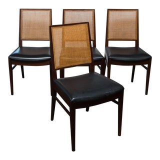 Set of Four John Stuart Walnut and Caned Dining Chairs