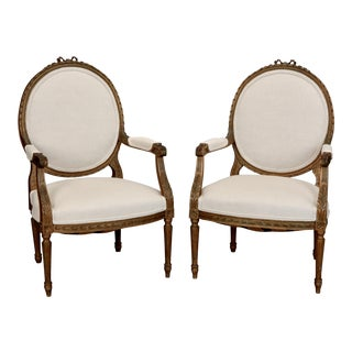 French Louis XVI Oval Back Gilded Frame Armchairs - A Pair