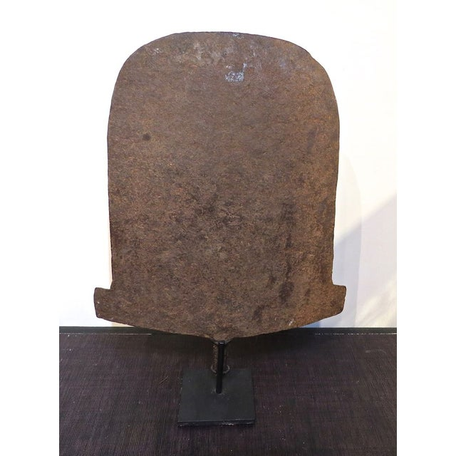 Image of Antique Nigerian Currency On Iron Stand