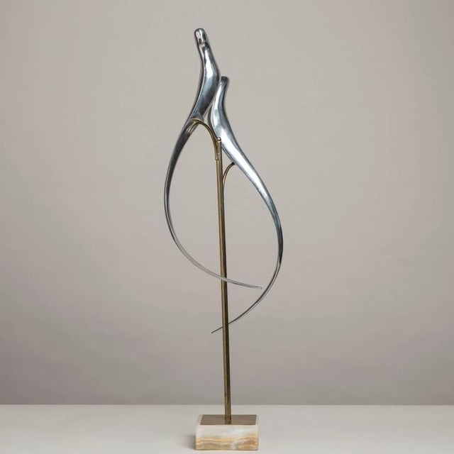 Image of Pair of Sculptural Polished Metal Birds by Curtis Jere, 1977