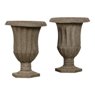 A pair of zinc urns from France