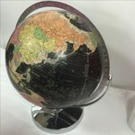 Image of Vintage Black World Globe with Silver Stand