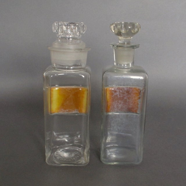 Image of Labeled Glass Apothecary Bottles - A Pair