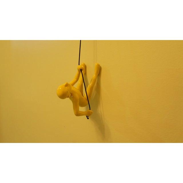 Image of Yellow Climbing Man Wall Art