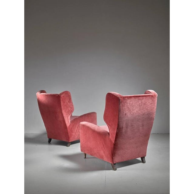 Image of Paolo Buffa Pair of Soft Coral Red Wingback Lounge Chairs, Italy, 1940s